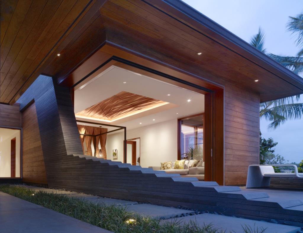 Nowoczesna, orgianlna elewacja dużego i nowoczesnego domu jednorodzinnego.